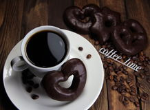 Cup of coffee with chocolate cookies and an inscription coffee time Stock Photos