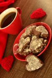 Cup of coffee and chocolate cookies in the shape of heart Stock Image