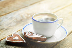 Cup of coffee with the chocolate cookies in the shape of a heart Royalty Free Stock Photos