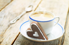 Cup of coffee with the chocolate cookies in the shape of a heart Stock Image