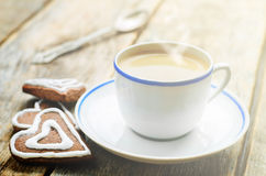 Cup of coffee with the chocolate cookies in the shape of a heart Stock Photos