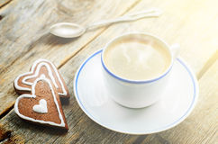 Cup of coffee with the chocolate cookies in the shape of a heart Royalty Free Stock Photo