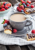 Cup of coffee and chocolate eclairs Royalty Free Stock Photos