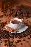 Cup of coffee with chocolate. Cup of coffee-flavored chocolate and ingredients around Stock Photo