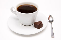Cup of coffee and a chocolate heart Royalty Free Stock Image