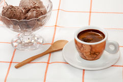Cup of coffee and chocolate ice cream served on the table.  Stock Image