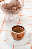 Cup of coffee and chocolate ice cream served on the table.  Stock Photo