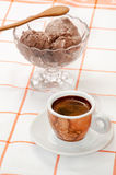 Cup of coffee and chocolate ice cream served on the table.  Royalty Free Stock Images