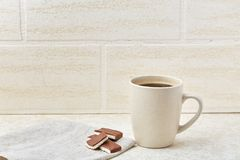Cup of coffee and chocolate isolated on the white background. Cup of coffee with cream and chocolate isolated on the white background. Concept image for Stock Photos