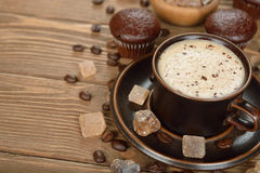 Cup of coffee and chocolate muffins Stock Photos
