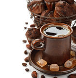 Cup of coffee and chocolate muffins Royalty Free Stock Images