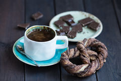 Cup of coffee with chocolate and pretzel Stock Photo