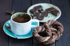 Cup of coffee with chocolate and pretzel Royalty Free Stock Images