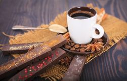 A cup of coffee and chocolate with spices. Stock Photography