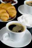 Cup of coffee with chocolate, sugarcubes and crois Stock Images