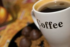 Cup of coffee and chocolate sweets Royalty Free Stock Photo