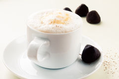 Cup of coffee  and chocolate truffles Stock Photography