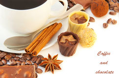Cup of coffee with chocolates, coffee grains Royalty Free Stock Image
