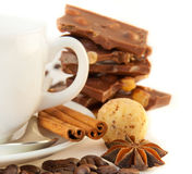 Cup of coffee with chocolates, coffee grains Royalty Free Stock Images