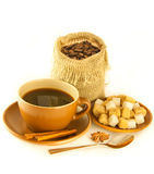 Cup of coffee with chocolates, coffee grains Royalty Free Stock Photography