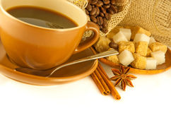 Cup of coffee with chocolates, coffee grains with Royalty Free Stock Photo