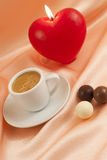 Cup of coffee with chocolates Stock Photos