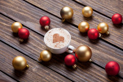 Cup of coffee and christmas bubbles Stock Photography