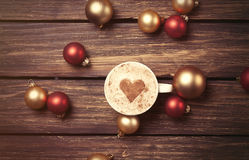 Cup of coffee and christmas bubbles Royalty Free Stock Photography