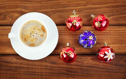 Cup of coffee and christmas bubbles Royalty Free Stock Photo