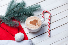 Cup of coffee and christmas candy Royalty Free Stock Image