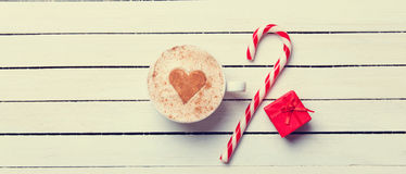 Cup of coffee and christmas candy Stock Images