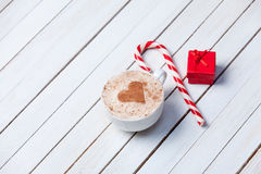 Cup of coffee and christmas candy Royalty Free Stock Images
