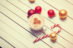 Cup of coffee and christmas candy Stock Photos