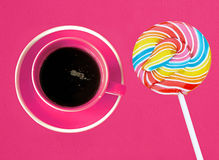 Cup of coffee and christmas candy lollipop Royalty Free Stock Images