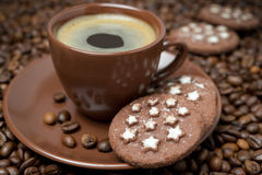 Cup of coffee and Christmas cookies on the coffee beans Royalty Free Stock Photos