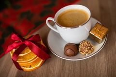 A cup of coffee on christmas festive table royalty free stock images
