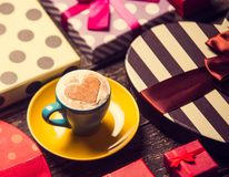 Cup of coffee and christmas gifts. stock photo