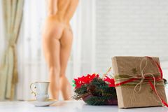 A cup of coffee and a Christmas present on the background of a n royalty free stock image