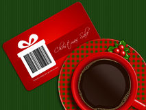Cup of coffee with christmas sale coupon on tablecloth Royalty Free Stock Photo