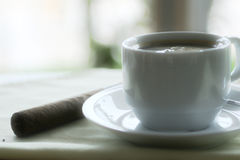 Cup coffee with cigar Royalty Free Stock Images