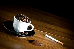 Cup coffee and cigarette Stock Images