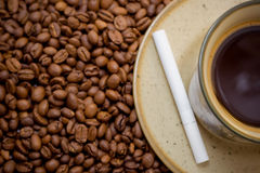 Cup of coffee and cigarette. Morning cup of black coffee with a cigarette Stock Image