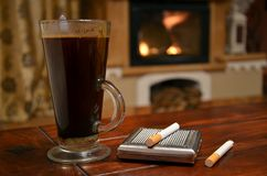 Cup of coffee, cigarette and snuffbox Stock Photos