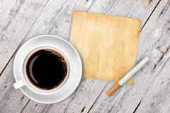 Cup of coffee with cigarette Stock Photo
