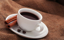 Cup of coffee with cinnamon. Cup of coffee with beans and cinnamon Royalty Free Stock Photos