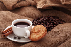 Cup of coffee with cinnamon. Cup of coffee with dessert and cinnamon Royalty Free Stock Images
