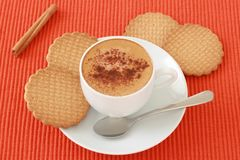 A cup of coffee with cinnamon Stock Images