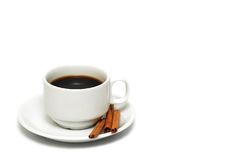 Cup of coffee with cinnamon. Isolated on white background Stock Image