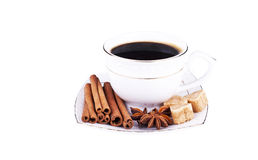 Cup of coffee with cinnamon, an anisetree and sugar. Cup coffee with cinnamon isolated on white background Royalty Free Stock Image