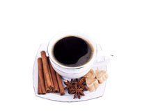 Cup of coffee with cinnamon, an anisetree and sugar. Top view of cup of coffee with cinnamon, an anisetree and sugar Stock Image